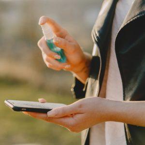 covid-person-holding-smartphone